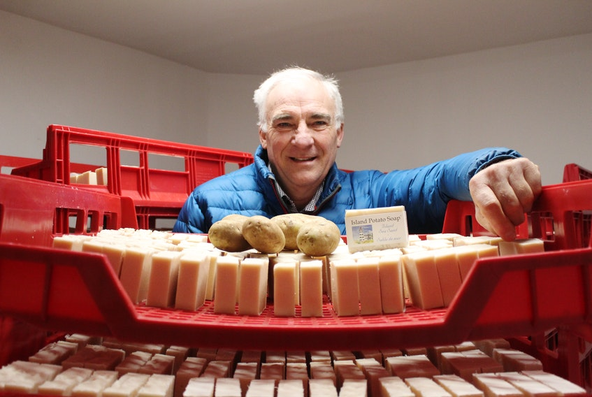 Pieter Ijsselstein surrounds himself with the star product of his company, Island Potato Soap Company. One of the main ingredients of his product is P.E.I. potato juice. Daniel Brown/The Guardian.