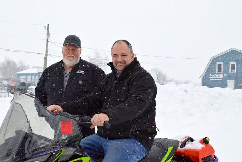 P.E.I. Snowmobile Association president Dale Hickox, left, and vice-president Grant Peters pose for a photo near the Confederation Trail in Winsloe. The group is concerned at the number of near-misses involving walkers and dogs on the Confederation Trail and reminds Islanders that while there is snow on the trails a lease agreement with the province says snowmobiles have the right of way.