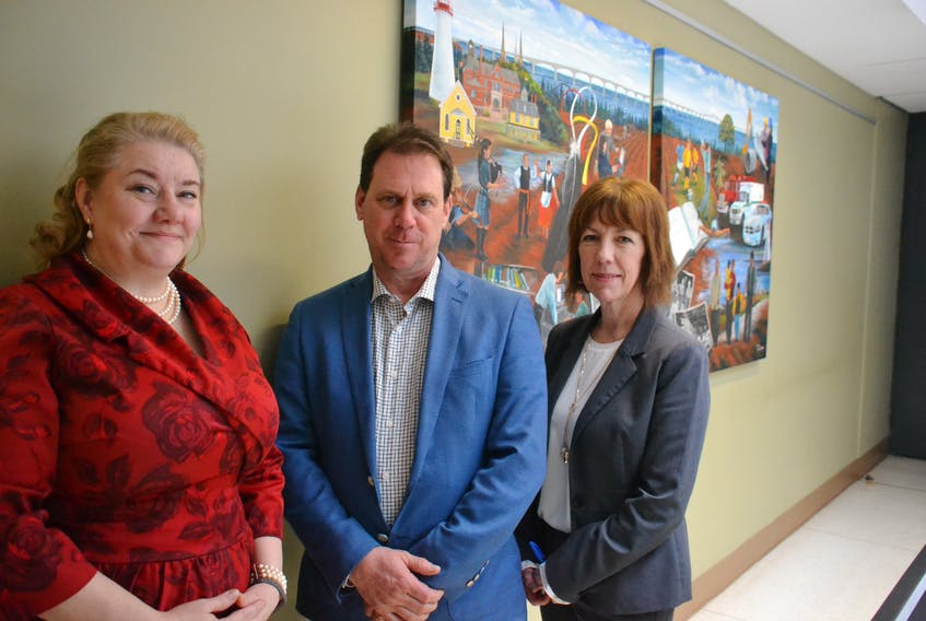 Heather Keizer, left, chief of mental health and addictions services, James Aylward, minister of health and wellness, and Verna Ryan, chief administrative officer for mental health and addictions, are shown outside the offices of the Department of Health and Wellness.