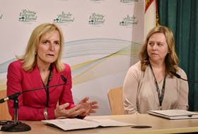 Dr. Heather Morrison, chief public health officer for P.E.I., left, and Marion Dowling, Health P.E.I's chief of nursing, allied health and patient experience, announce closing of nursing and long-term care facilities to visitors on Sunday. Michael Robar/The Guardian