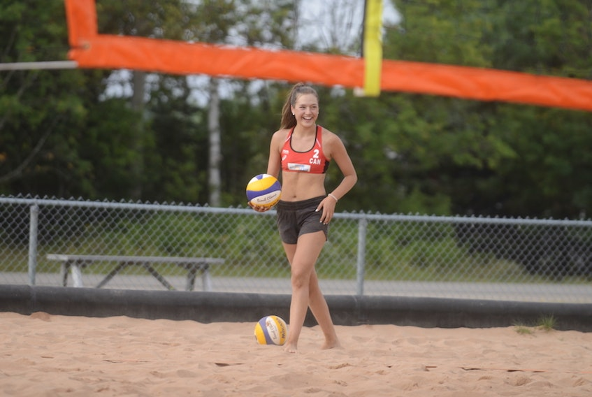 Marie Fogarty gets ready to serve Thursday in Cornwall at a practice of the Team P.E.I. women's beach volleyball training squad for the 2021 Canada Games.