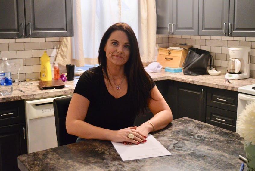 Ellen Taylor sits in her kitchen in Charlottetown with a copy of a letter she sent to Health Minister James Aylward that raised concerns about addiction treatment options in P.E.I.