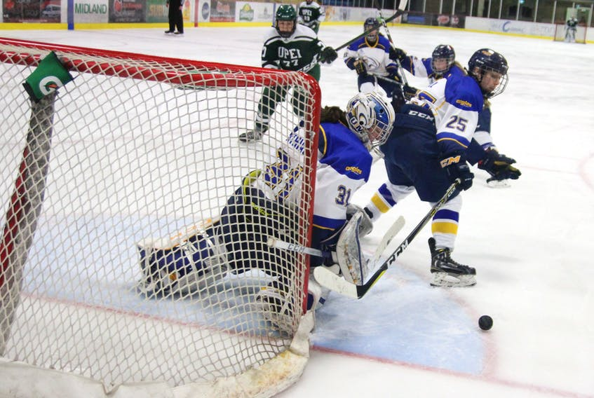 Université de Moncton Aigles Bleues goaltender Audrey Berthiaume keeps her eyes on a rebound during Sunday's Game 2 of the Atlantic University Sport quarter-final with the UPEI Panthers in Moncton. Normand A. Léger/Special to The Guardian