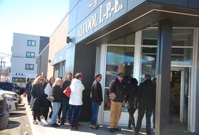Customers line up outside Oak Tree Place liquor store in Charlottetown Wednesday afternoon to stock up on supplies. As of Thursday at 2 p.m., all 17 liquor stores throughout Prince Edward Island will be closed until further notice. This comes after an agreement between Dr. Heather Morrison, the province's chief public health officer, and cabinet that liquor and cannabis corporations are not an essential service.