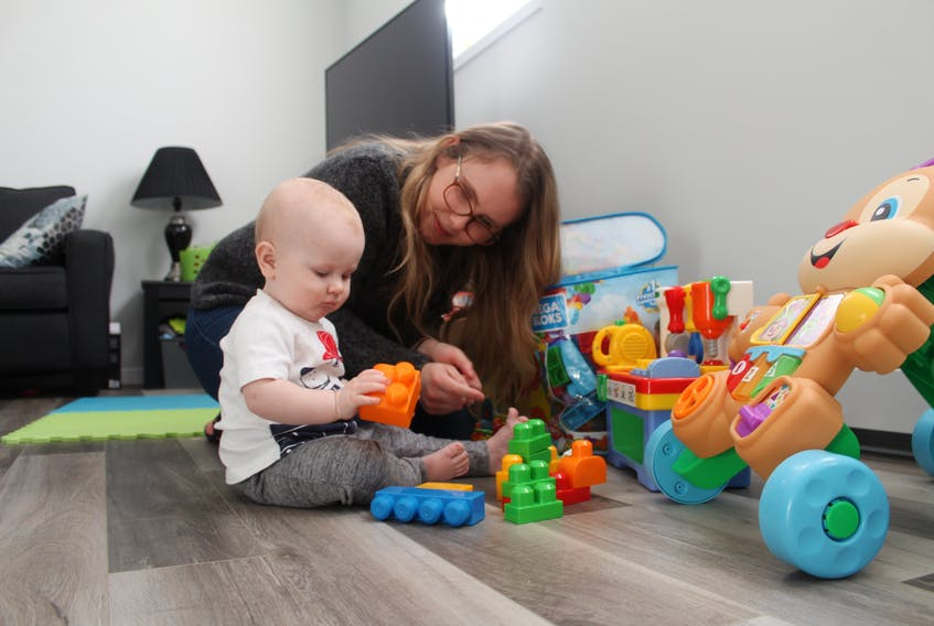 Megan Crozier plays with her 11-month-old son Chance at their home in Charlottetown. Chance has been on a waiting list for childcare since he was two months old.