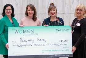 Kathleen Casey, left, and Aileen Matters, right, present Blooming House co-founders Brynn Devine and  Liz Corney, second right, with a cheque from money raised at a recent meeting of 100 Women Who Care, P.E.I. chapter.