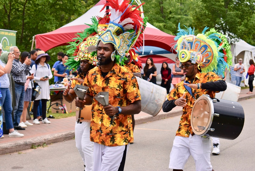 Members of the Rush Bohemian Jonkanoo band march along the Montague waterfront during the DiverseCity Multicultural Festival held in Three Rivers on July 14. The event was part of the larger Montague Summer Days Festival.