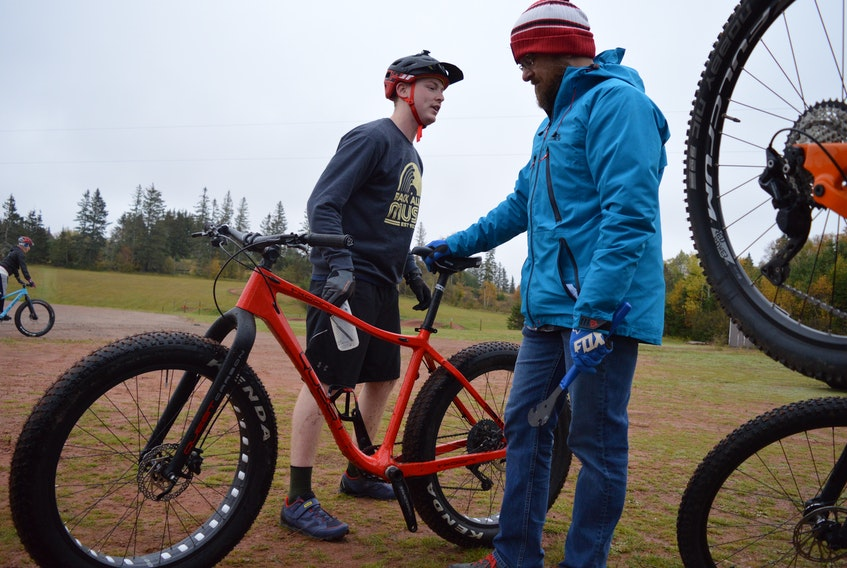 Mountain biker Patrick Cheverie, left, discusses his ride with mechanic Geoff Murray at the Mark Arendz provincial park recently.