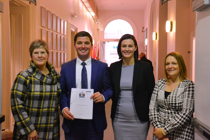 PC MLA Cory Deagle (centre), flanked by Jane Parsons (left), Kelly Cull (middle right) and Jayna Stokes (right) of the Canadian Cancer Society stand outside the P.E.I. legislature. MLA's unanimously voted to increase the minimum vaping and smoking age to 21. Stu Neatby/THE GUARDIAN