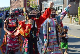 Members of P.E.I.'s Aboriginal community take part in a peaceful march in downtown Charlottetown on Friday.