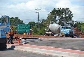 Construction workers are shown on the site of an under-construction roundabout at the corner of St. Peters Road near the perimeter highway. A three-year-old City of Charlottetown plan proposes the construction of three other roundabouts along St. Peters Rd.