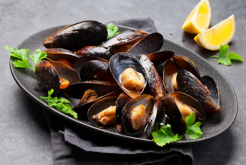 There are many ways to serve mussels, but one of the easiest is steamed with tomato sauce, parsley and lemon.