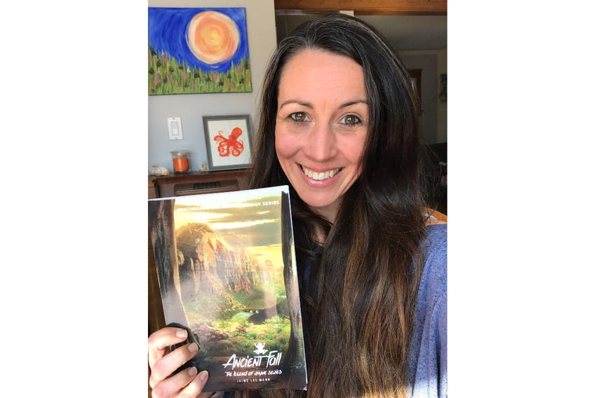 Jaime Lee Mann holds a copy of her latest book, Ancient Fall: The Legend of Rhyme Series.  The book was launched this past September. It's available at the Book Mark, Indigo, Coles and through Amazon.