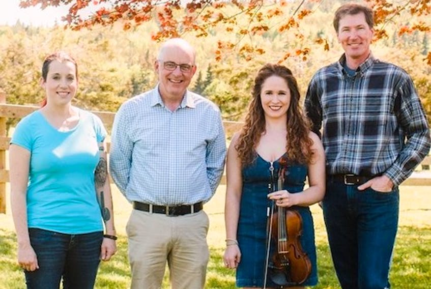 Fiddler's Sons with Eddy Quinn, right John B. Webster, Keelin Wedge, left, and Courtney Hogan-Chandler will perform tonight at the Benevolent Irish Society.