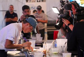 Chef Nick Chindamo puts the final touches on his dish, while under the pressure of cameras and a live audience at the P.E.I. International Shellfish Festival in Charlottetown on Sept. 22. - Daniel Brown