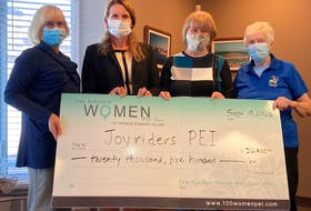 Aileen Matters and Cheryl Paynter from 100 Women Who Care, join Janice Cole, past president, and Daphne Davey, president  from Joyriders P.E.I.