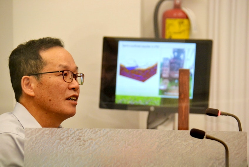 Hydrogeologist Yefang Jiang speaks before a recent standing committee meeting. Jiang has developed a model to predict the impacts on one P.E.I. watershed of expanded use of high capacity wells.