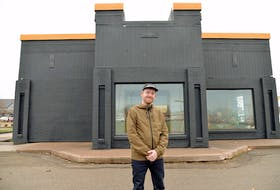 Bruce Rooney, general manager of Nimrods', stands in front of the newly painted former KFC building in Stratford. Nimrods' is planning to open a year-round restaurant at that spot the first week of December.