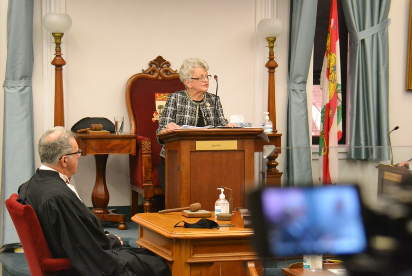 Lt.-Gov. Antoinette Perry (centre) reads the 2021 speech from the throne before the P.E.I. legislature. Seated at left is Speaker Colin LaVie.