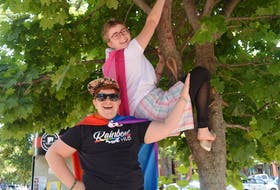 Rory Starkman, left, youth services co-ordinator with Peers Alliance, and Maddy Power-Lockman, community co-ordinator, say having some wacky fun is part of the plan for Pride Week activities, July 26-Aug. 2.