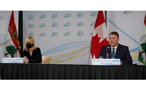 P.E.I.'s chief public health officer Dr. Heather Morrison, left, and Premier Dennis King attend a news conference Monday, Nov. 23, announcing the province would be withdrawing from the Atlantic travel bubble for two weeks from Nov. 24 to Dec. 7.