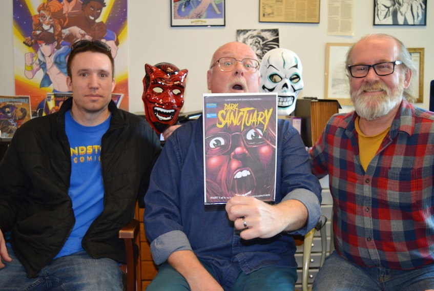Robert Doan, left, and Sandy Carruthers, right, with Sandstone Comics, have jumped into the horror genre with Dark Sanctuary, written by Charlottetown writer Dave Stewart.