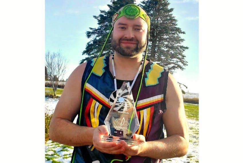 Richard Pellisier-Lush holds the National Indigenous Coaching Award he won in November.