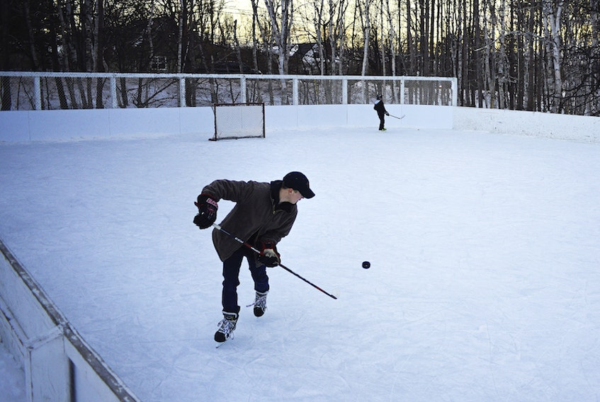 Sam Weeks, 22, practises his puck-handling skills while out for a skate at the Bunbury Outdoor Rink in Stratford on Saturday. A number of people took advantage of the nice weather, which included temperatures around 0 C, to get out and enjoy the February day.