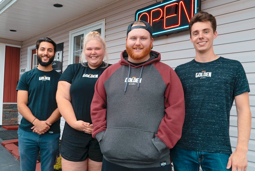 Coltin Handrahan, right, owner of Golden Custom Clothing, and his team, from left, Daniel Timen, Abby Kinch and Porter Smith, have come up with a business idea they hope will help businesses that have been shut down and artists who aren't working or touring due to the current pandemic. They're offering to design custom-fundraising T-shirts, sell them to Islanders for $25 and donate $10 from each sale to the business or artist to help pay for their expenses during this challenging time.