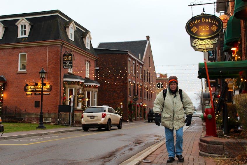 Charlottetown resident Rod Scott walks along Sydney Street, between Queen and Great George streets, on Nov. 28.