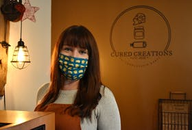 Helena Wood, co-owner of Cured Creations, stands behind the counter of her small shop located inside Back Alley Music. She has been reaching out to vendors affected by the cancellation of the Victorian Market and offering up her space for those wanting a pop-up location.