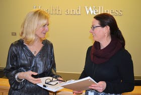 Dr. Heather Morrison, left, P.E.I.'s chief public health officer, talks with Erin Bentley, senior public health policy and planning officer in the Department of Health and Wellness's communicable disease program on Friday following a media briefing on COVID-19. Morrison said there are no confirmed cases of the coronavirus on P.E.I. and her office in receiving updates five times a week from the national chief public health office.