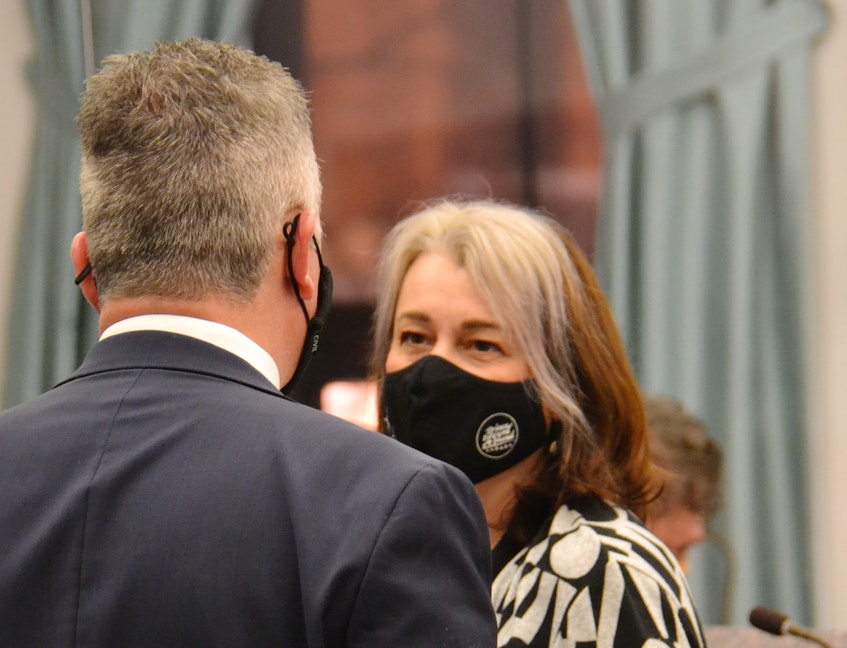 Green MLA Hannah Bell, seen here chatting with Liberal MLA Heath MacDonald before a legislative session, took aim at the Progressive Conservative government's record on women's health, justice and economic development issues on Friday. - Stu Neatby