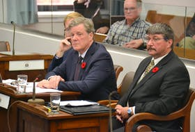 J. Scott MacKenzie, chairman and CEO of the Island Regulatory and Appeals Commission, takes questions from MLAs during a meeting Tuesday of the standing committee on natural resources and environmental sustainability. Seated with MacKenzie's is Jonah Clements, left,, director of land and general counsel for IRAC and Doug Clow, right, vice-chair of IRAC.