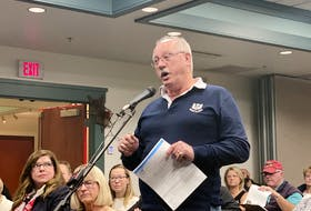 Danny Woods, a Millennium Drive resident, gives his comments and concerns about the traffic, accessibility and property value revolving around the potential rezoning of Reddin Meadows in Stratford. Wood spoke at a Wednesday, Nov. 27, public meeting at Stratford Town Hall.