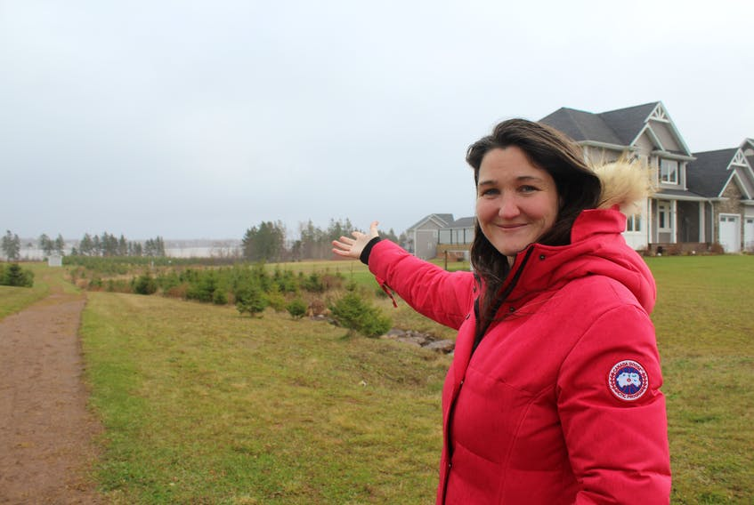 Karralee McAskill, co-ordinator with the Cornwall Area Watershed Group, shows where residents of Sunrise Cove want to take away trees to maintain their water view. McAskill says removal of the trees will have long-term ecological effects for wildlife and water in the area.