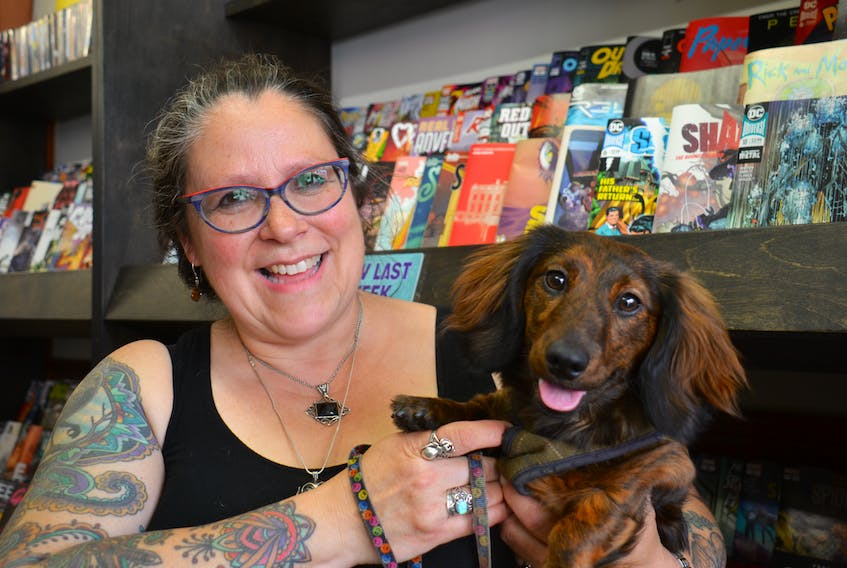 Sue Smith, co-owner of The Comic Hunter in Charlottetown, always brings her dog, Mazzy, to work. Smith isn't sure what she'd do if a pet-related incident occurred.