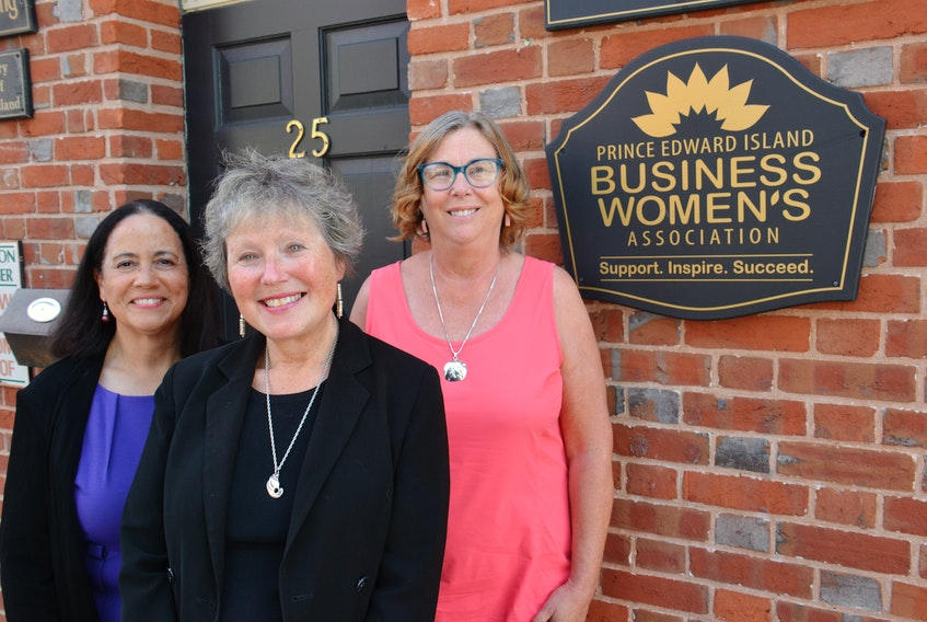 Miriam Briggs, right, Margaret Magner and Cathy Rose of the P.E.I. Business Women's Association stand outside their office in downtown Charlottetown on July 11. The organization just received $485,000 from a federal government investment.