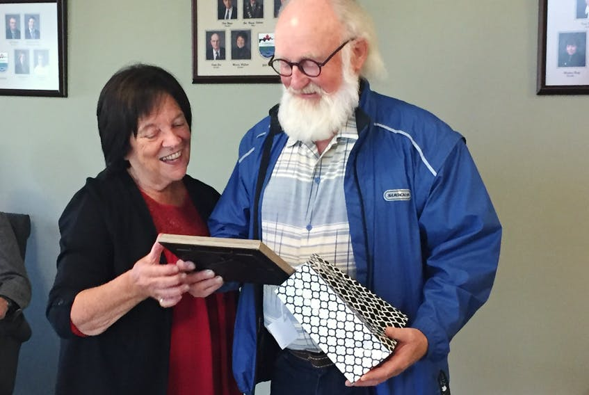 Cornwall Mayor Minerva McCourt presents a small token of thanks to Bill Hogg for his work in the community, especially his work around the new Terry Fox Sports Complex, its Naturalization Gallery and a 1.8 kilometre unnamed trail, lined with Acadian forest trees.