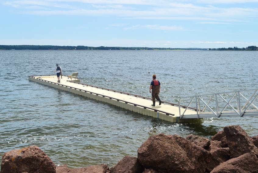 Workers with East Coast Docks put the finishing touches on the floating dock at Victoria Park last year in this file photo. Charlottetown's parks and recreation committee is recommending the dock become a permanent fixture. Council will likely make its decision at Monday's regular monthly meeting.