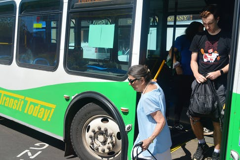 Passengers get off the bus on Grafton Street in Charlottetown on Wednesday. While funding was recently announced for six new diesel buses for T3 Transit, the City of Charlottetown says it is interested in converting over to electric buses in the future.