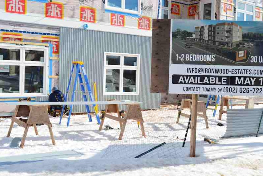 A construction worker works outside on this project on Kensington Road in Charlottetown on Wednesday. The housing complex will be a mix of one- and two-bedroom units.