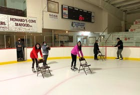 Krista Locke-Ellis, executive director of the Western Region Sport and Recreation Council, left, watching the second group of newcomers practice skating for the first time.