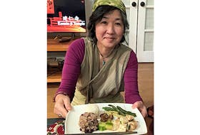 Summerside resident Tomoko Craig shows off the traditional Japanese dish she made for her Cooking with Culture presentation.