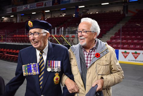 Veteran George Olscamp, 100, laughs with son, David, after the 2019 Remembrance Day ceremonies at Credit Union Place, Summerside.