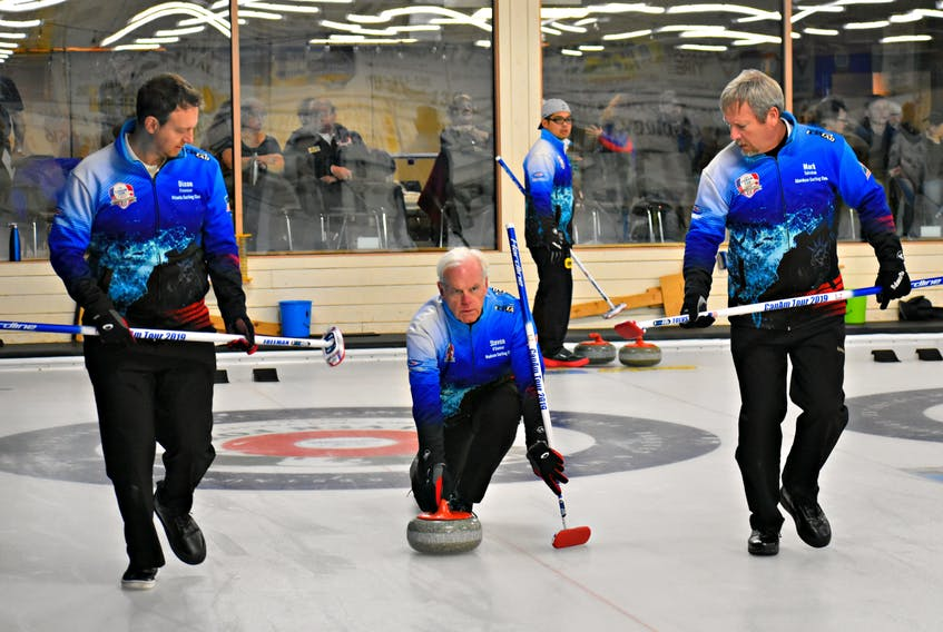 Americans, from left, Dixon Freeman, Steven O'Conner and Mark Tolvstad curled in Summerside Sunday as part of the Canam Cup.