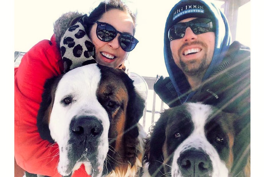 Kolby Perry, left, and her husband, Adam, with their dogs Jasper, left, and Georgia.