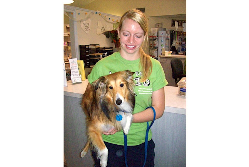 A 2010 photo of Crystal Isherwood and her dog, Aussie.