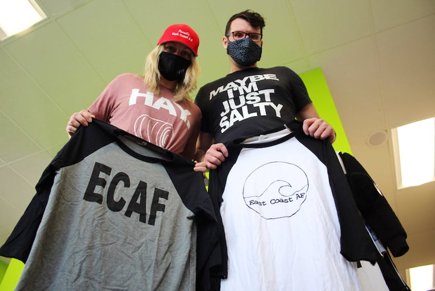 Megan McDonald and Luke Walker show off some of the apparel from their clothing brand ECAF.