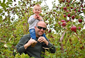 Mitchell Phillips and his nephew Chase Ramsay come every year to pick apples at Arlington Orchards.